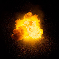 Realistic fiery explosion over a black background
