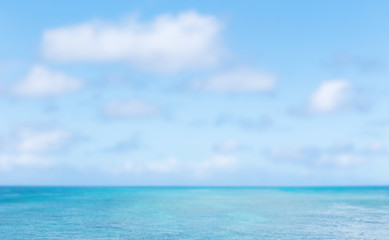 Blurred image of sea and blue sky background. blurred nature bac
