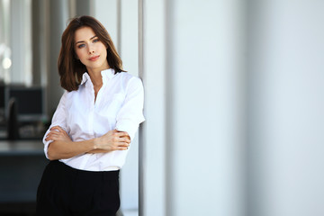 Modern business woman in office with copy space
