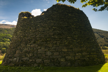 Scotland. Highlands. May 2016. A photograph of Dun Troddan, an Iron Age Broch near Glenelg in the Scottish Highlands showing the the rear of the building and it's external shape.
