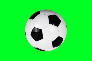 Fußball vor grünem Hintergrund