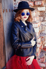 stylish girl in black leather jacket and long skirt