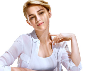 Pretty girl with beautiful makeup in white shirt, looks at camera. Photo of attractive blonde girl on white background. Youth and skin care concept