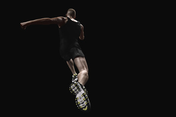 athlete running in black background-3d rendering