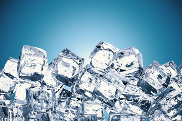 heap of ice cubes on blue background