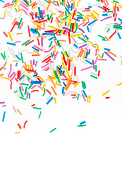 Colorful candy sprinkles isolated on white background card