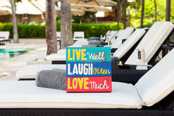 Inspirational Motivational Life Quote wooden board Live Well Laugh Often Love Much on summer