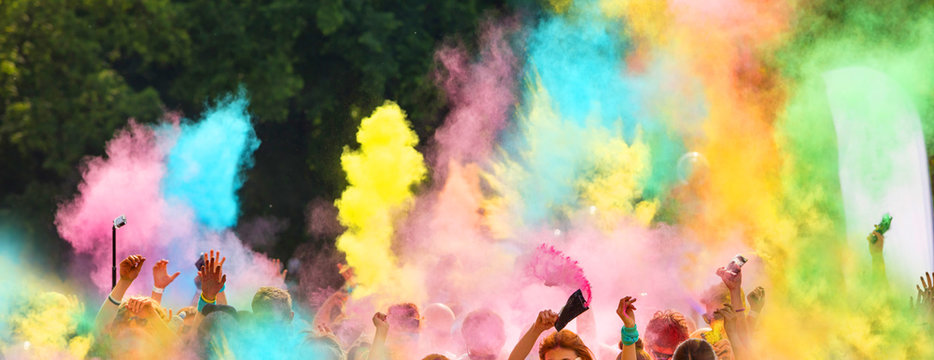 Crowd of people throwing colored powder