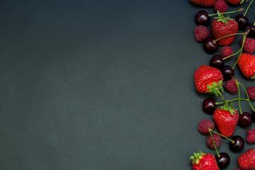 Red Fruit Strawberries, Raspberries And Cherries Flat Lay On Black Background