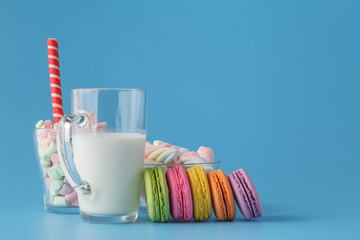 colorful macarons in transparent cup on table