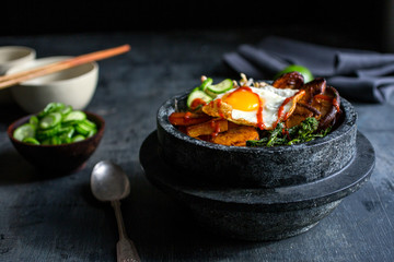 Fresh vegetables in bowl with fried egg