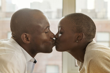 Couple at home kissing