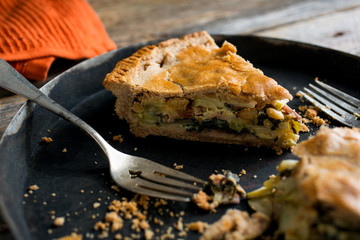 Slice of apple chard pie on plate