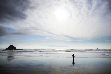 Silhouette of boy (4-5) on beach