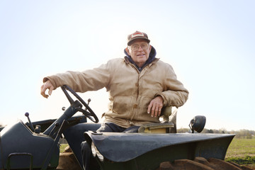 Portrait of farmer on tractor