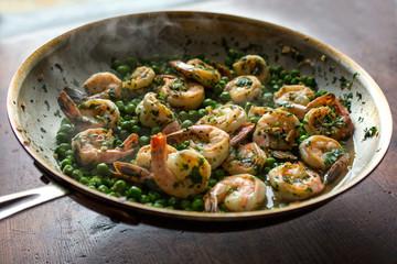 Green garlic shrimp cooking in pan