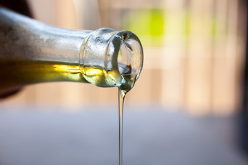 Oil pouring from bottle