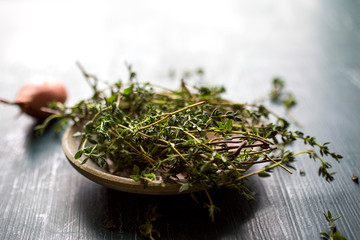 Fresh herbs in wooden bowl