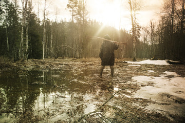 Young man in swamp in winter