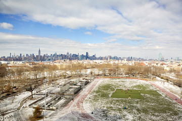 Areal view of soccer field with Manhattan skyline in background