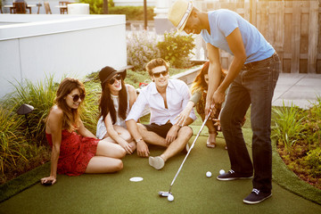 Group of friends playing golf