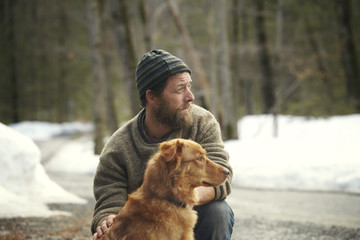 Man with dog on road in forest