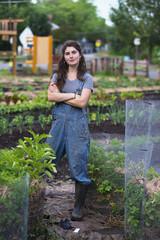 Female farmer standing in vegetable garden