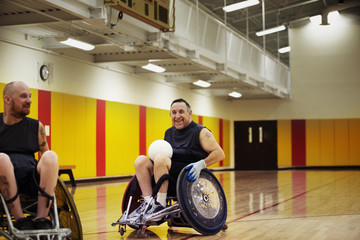 Wheelchair rugby player laughing during game