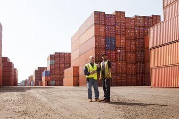 Worker talking with each other at cargo warehouse