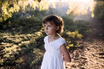 Girl (8-9) standing in backlit