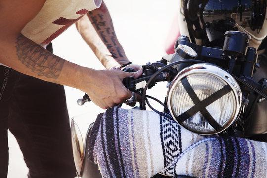 Young man repairing his motorcycle