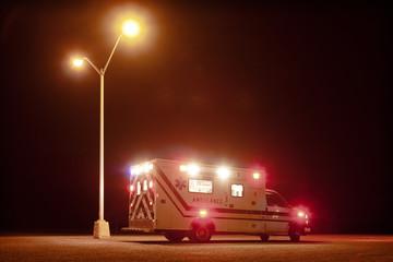Ambulance on road at night