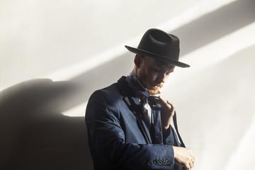Portrait of man tying tie