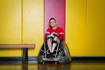 Portrait of disabled athlete in locker room