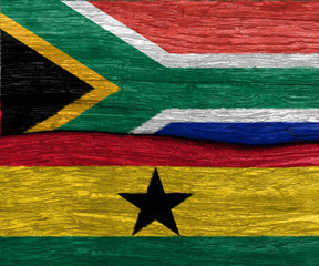 aouth africa and ghana flag on wood texture background floor