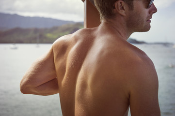 Shirtless back of mid adult man