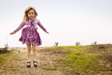 Portrait of girl (4-5) jumping