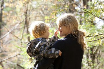Mother with son ( 2-3 ) in forest