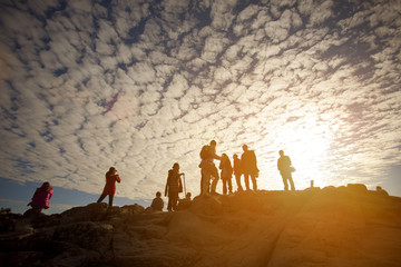 Silhouettes of hikers on mountain