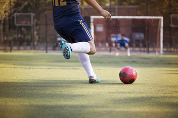Cropped image of man playing soccer at field