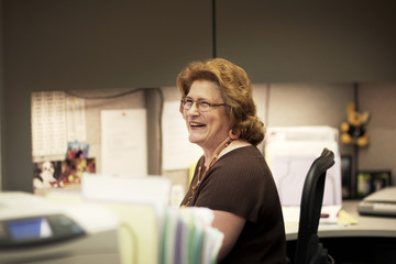 Business woman laughing in office