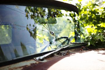 Close-up view of broken window in old truck