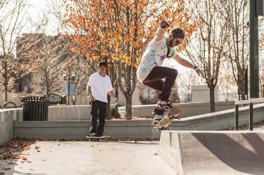 Young men skateboarding in skateboard park