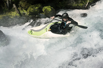 High angle view of man rowing kayak in river