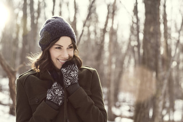 Woman in forest in winter