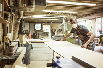 Portrait of carpenter standing in workshop