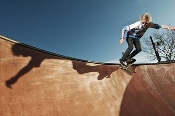 Young man skateboarding in skateboard park
