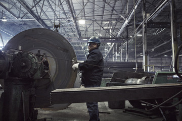 Mature man working at steel mill