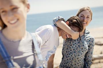 Playful friends enjoying at beach