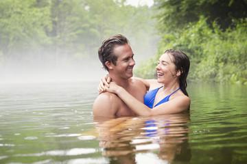 Couple embracing in lake
